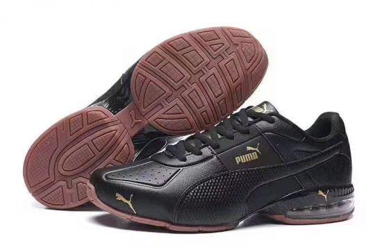 Puma Surin Black and Gold Dark Shadow Sneakers